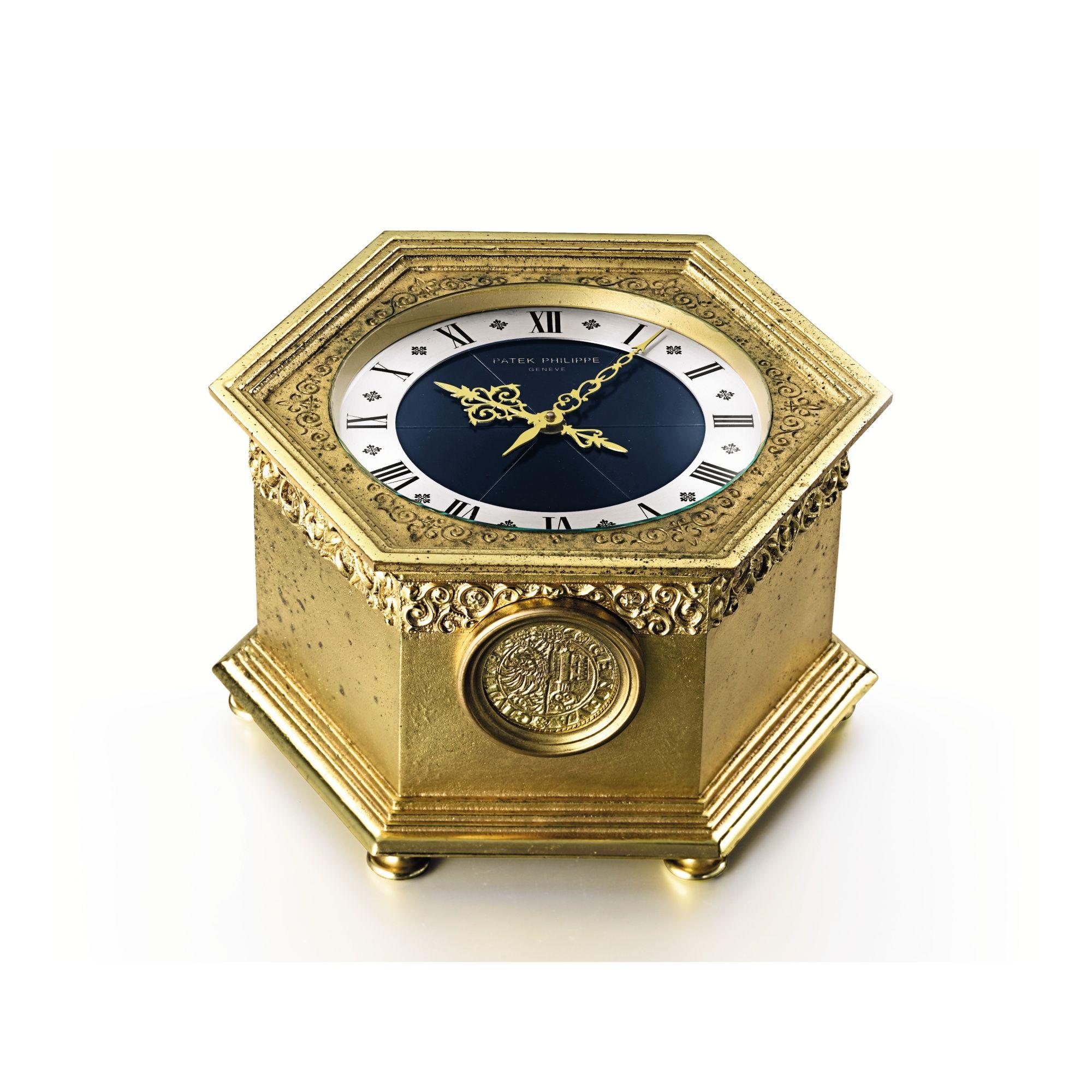 PATEK PHILIPPE A GILT BRASS HEXAGONAL SOLAR POWERED QUARTZ TABLE CLOCK 1976 CASE 1800331