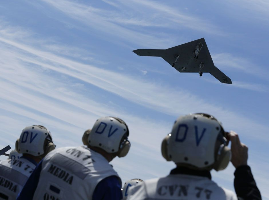 An X-47B drone launches for the first time off an aircraft carrier, the USS George H. W. Bush, May 14, 2013.