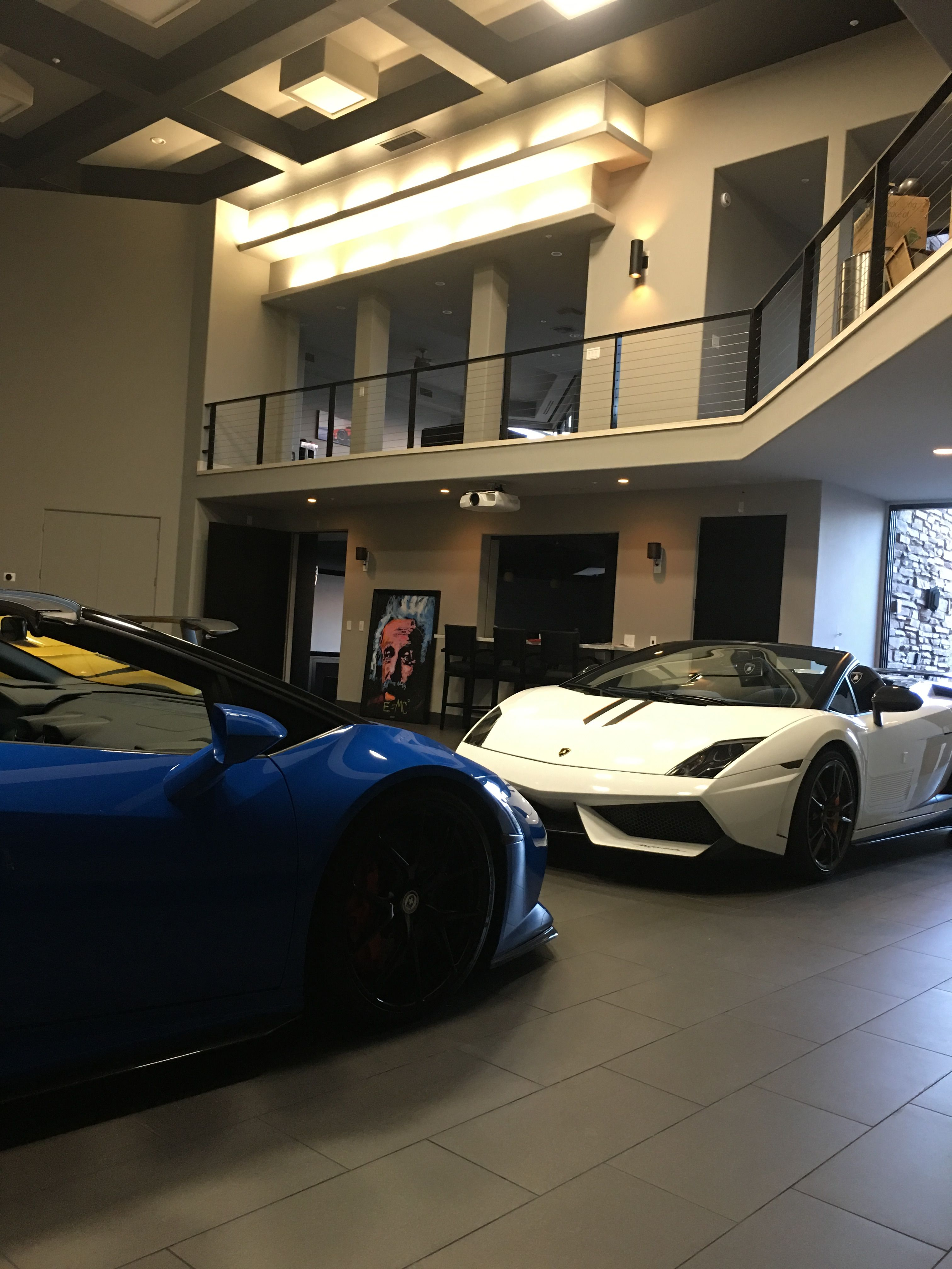 Luxury garage full of Lamborghini\'s with an office loft and ...