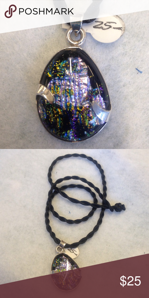 Dichroic glass and silver pendant Dichroic glass and silver pendant on Dollie neck cord.  22 inches.  13.3 grams Jewelry Necklaces