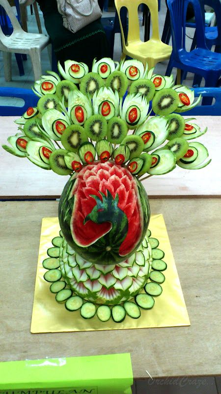 Carved out peacock from watermelon combined with other