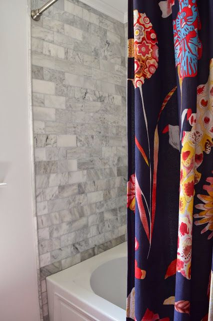 Carrera marble subway tile in bathroom remodel. Anthropologie shower on ikea bathroom design, waterworks bathroom design, houzz bathroom design, kelly wearstler bathroom design,