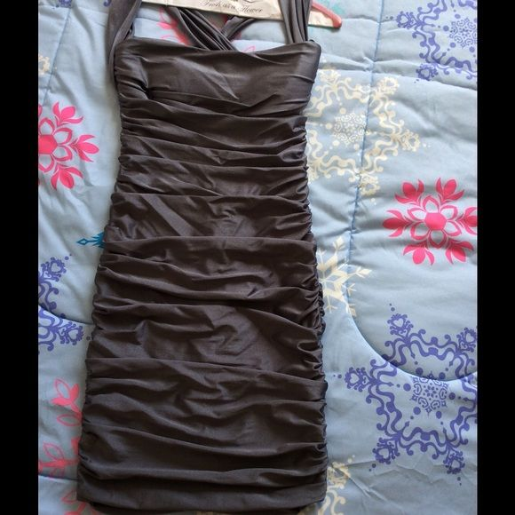 Small Dark Gray Bodycon Dress Worn once. Fabric stretches a bit for wiggle room. Has a criss cross back with hook and zipper closure.  Super comfy and easy to move around it. Dresses