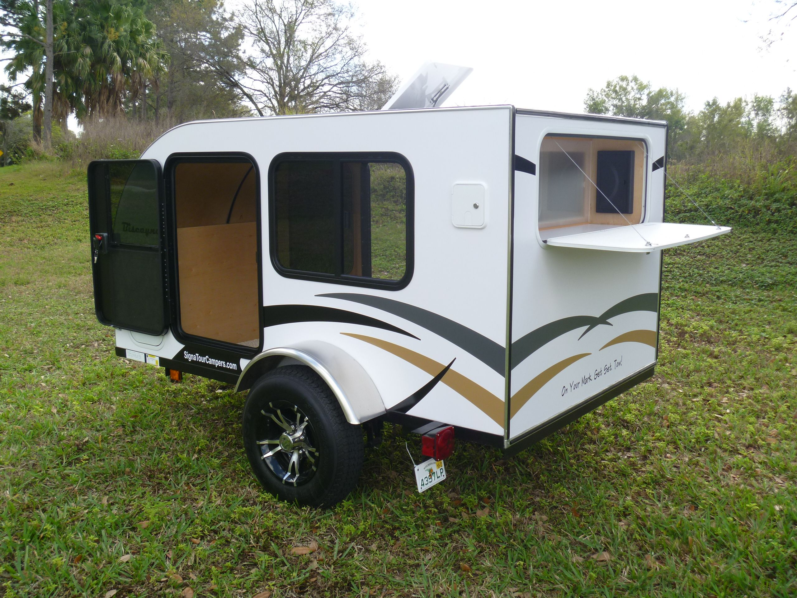 Teardrop camper with rear access door signatourcampers