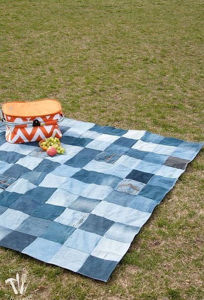How to Make an Awesome WaterResistant Picnic Blanket From Old Jeans is part of Upcycled Crafts Awesome Blue Jeans - She cuts up old jeans 121 squares  Now watch what she does with a shower curtain  GENIUS backyard idea! This might be the coolest thing you'll see all day! If you are anything like me, your family goes through lots of jeans