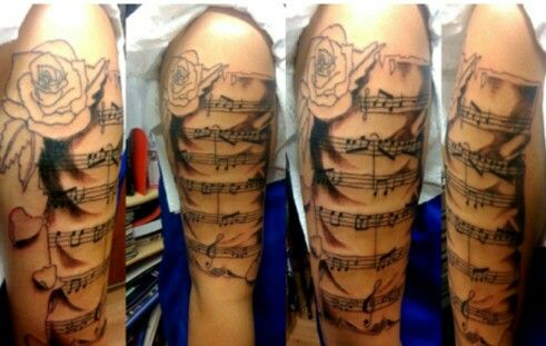 Music Arm Tattoo With Images Tattoos Sheet Music Tattoo