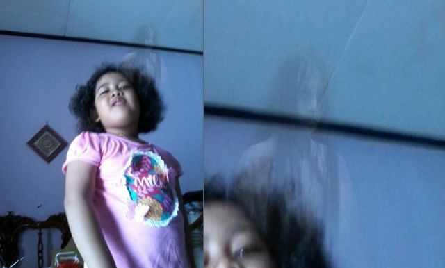 Haunting Image Shows Ghost Behind 5 Year Old Indonesian Girl Ghost