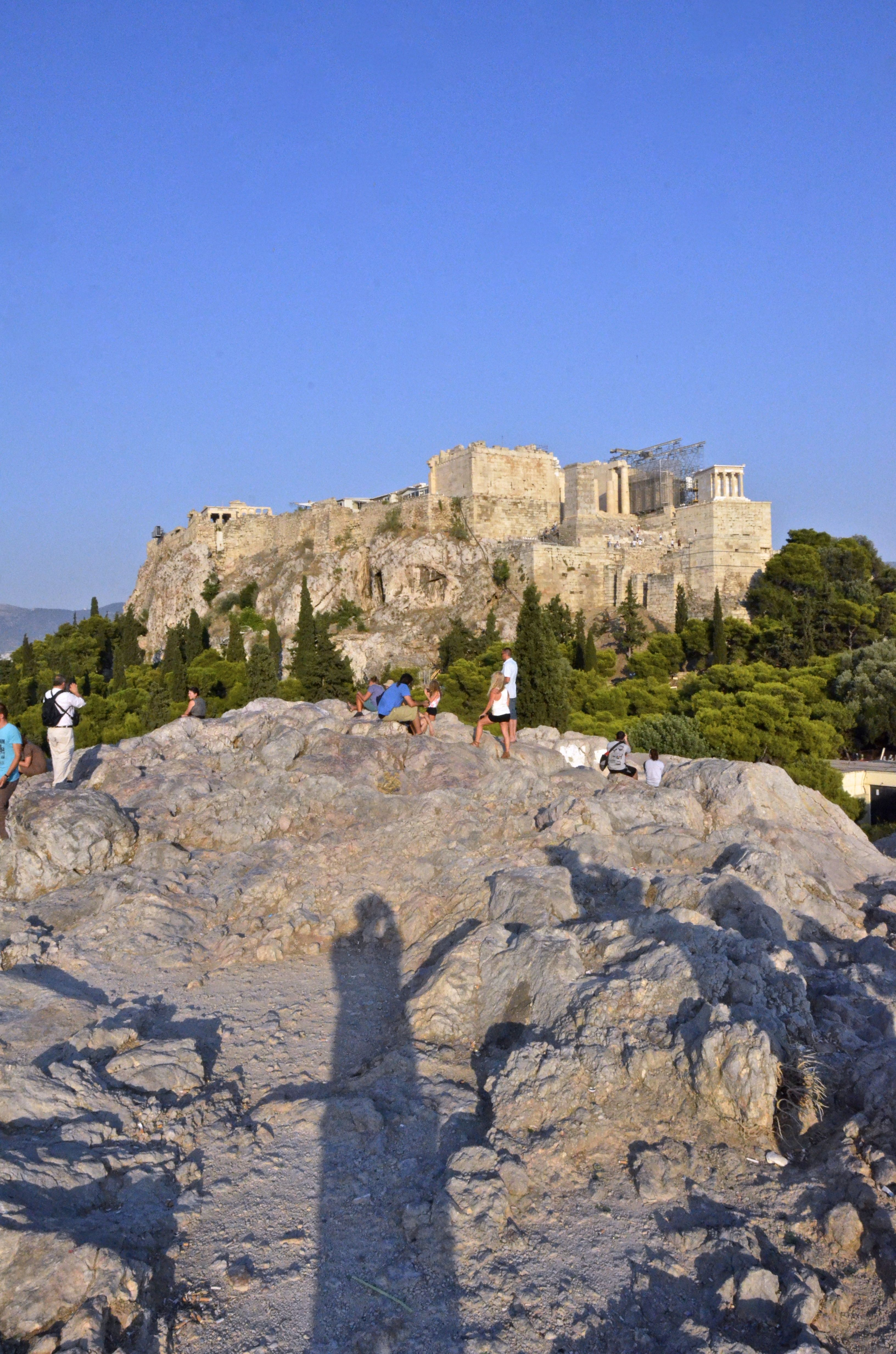"""Standing where apostle Paul said """"Now what you worship as something unknown I am going to proclaim to you. The God who made the world and everything in it is the Lord of heaven and earth and does not live in temples built by hands."""" and watching the sunset looking at the Athenian Acropolis was nice"""