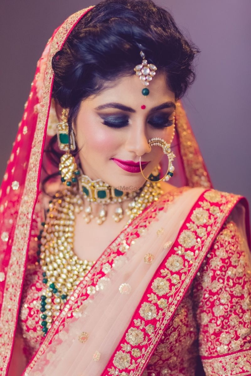 Smokey Eyes With Pretty Red And Golden Lehenga For Wedding