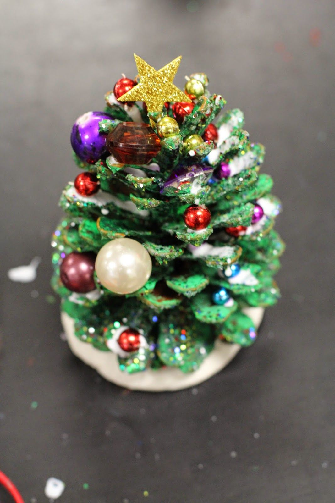 The past two weeks every grade level has been creating for Pine cone christmas tree craft