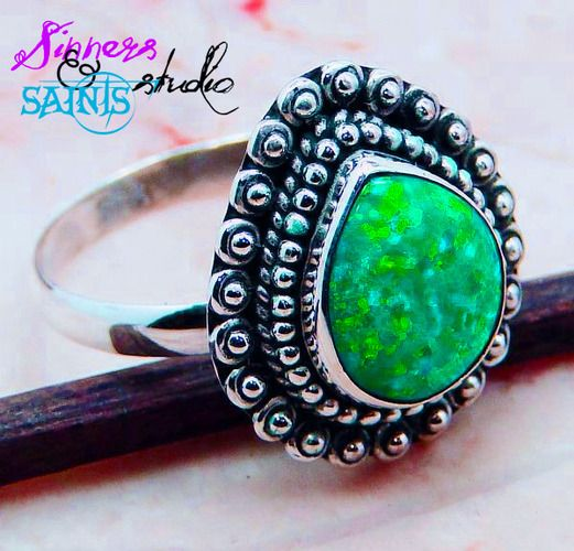 Amazing Green fire opal in stamped 925 GENUINE Sterling silver. Not plated, not made in China. Made right here in the USA.     My sterling items are never imported. I have this ring in stock and ready to ship with payment today!     Thank you for looking!