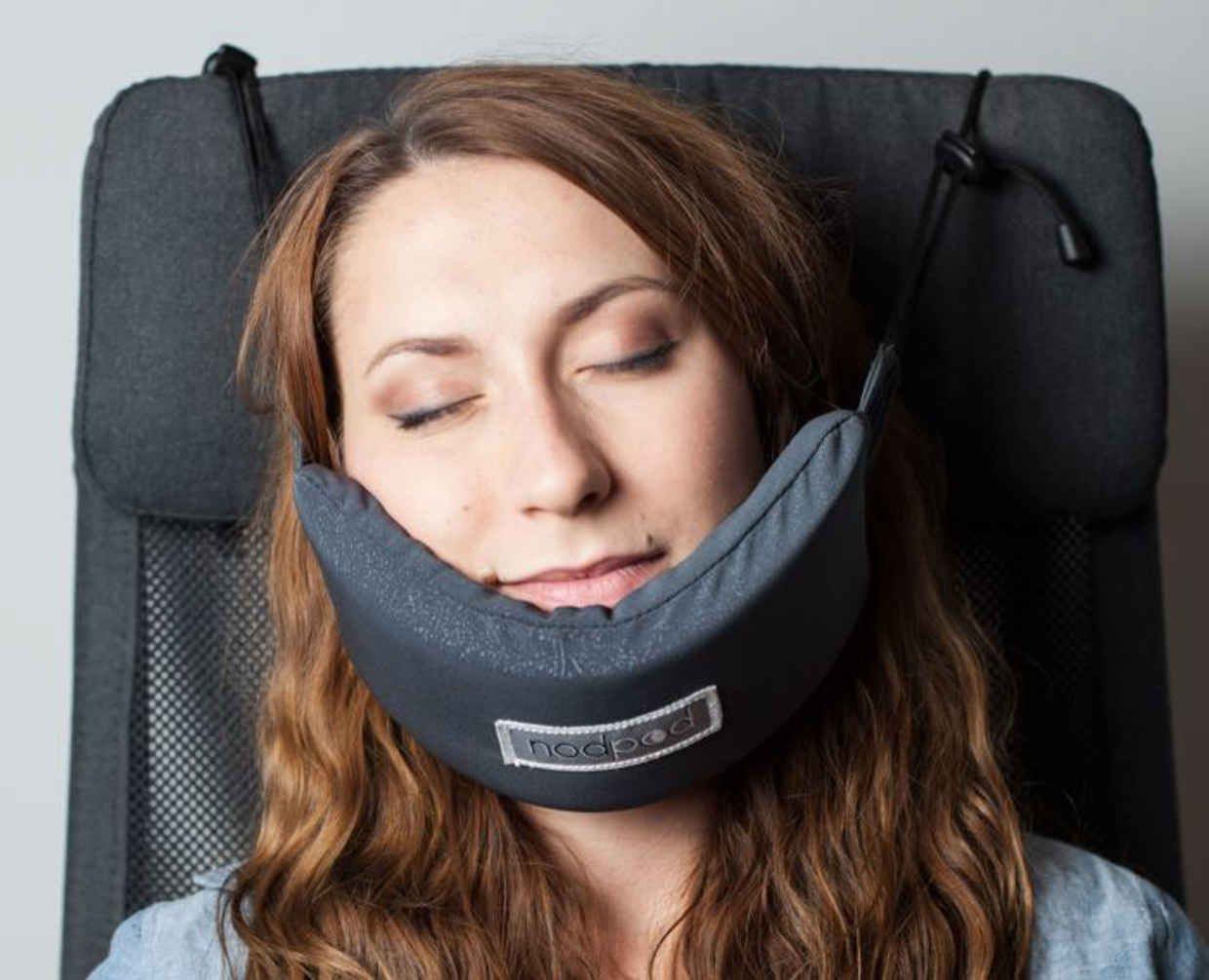 Someone Finally Invented A Head Hammock That Makes Falling Asleep Whilst Travelling Easy Sleeping On A Plane How To Fall Asleep Travel Pillow