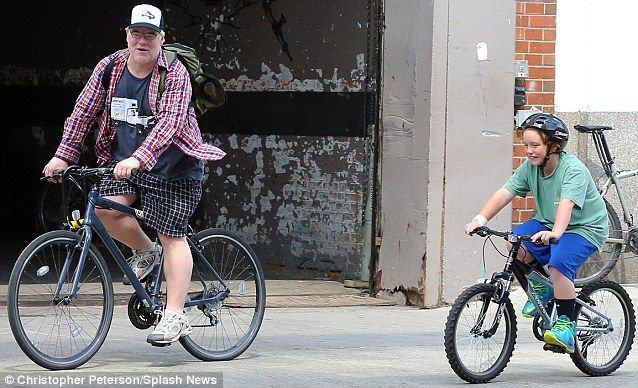 Like father, like son - Philip Seymour Hoffman and offspring Cooper enjoy a ride together
