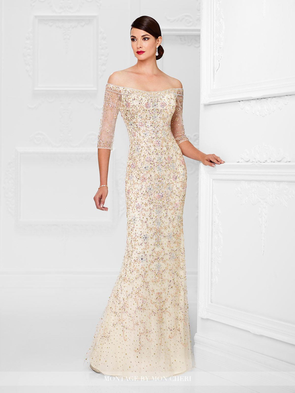 c72bf32e067 Off-the-shoulder tulle sheath encrusted with hand-beading features beaded  illusion three-quarter length sleeves. Sizes  4 – 20 Colors  Ivory Multi