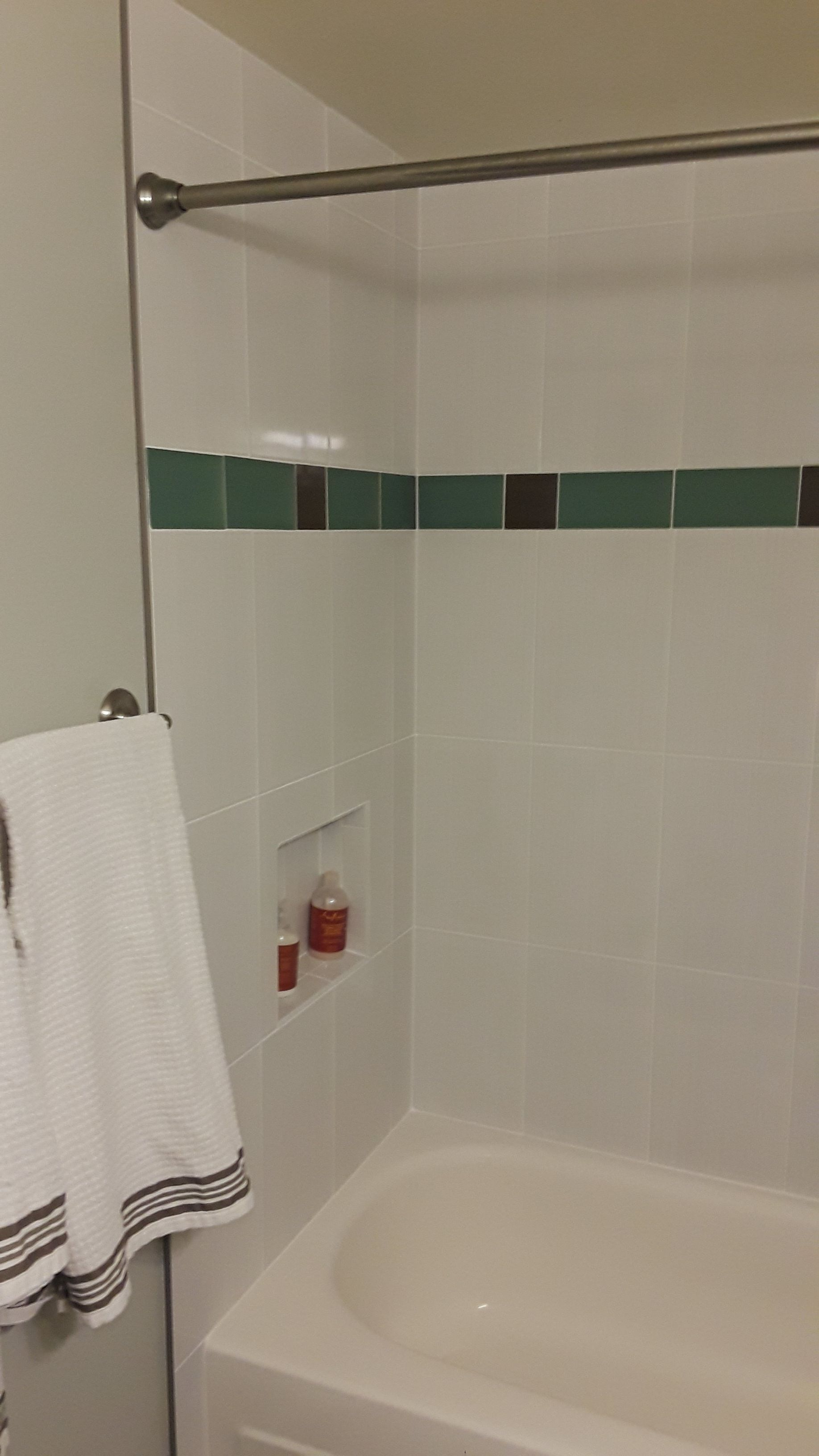Blairlock White Ceramic Tile 10 X 16 For Tub Surround Along With An Accent Row Of Green Beach Glass Tile From Pen Tub Surround White Ceramic Tiles Bathroom Tub