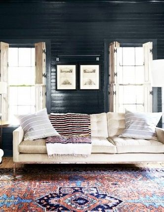 times  rug made the room also planked walls black wood and plank