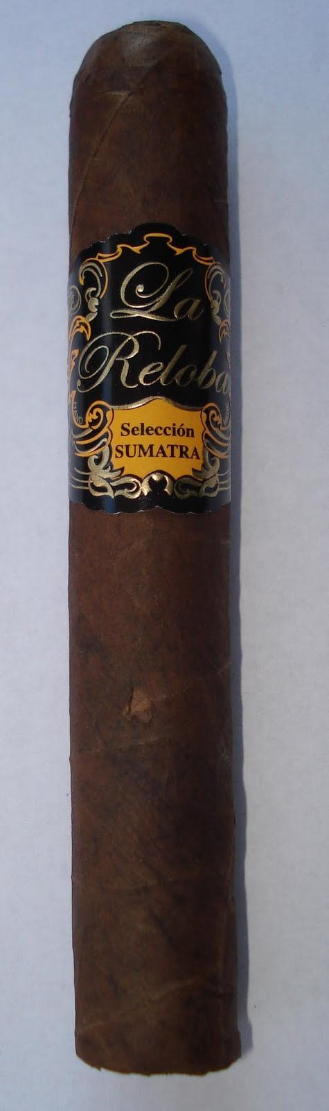 "La Reloba Selección Sumatra MADE BY: My Father Cigars S.A. FACTORY LOCATION: Nicaragua WRAPPER: Ecuador BINDER: Nicaragua FILLER: Nicaragua PRICE: $6.50 RING GAUGE: 52 LENGTH: 6 1/8"" RATING: 92"