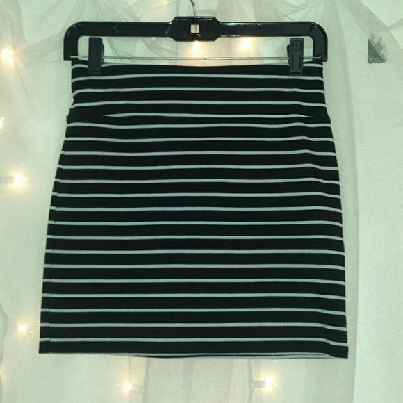 Black striped skirt Black/white striped bodycon skirt from American Eagle. A little wear on the back but still in good condition! American Eagle Outfitters Skirts Mini