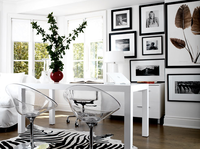Modern White Office Design With Parson Desk Black Zebra Cowhide Rug Tapered Lamp Acrylic Lucite Chairs And Photo