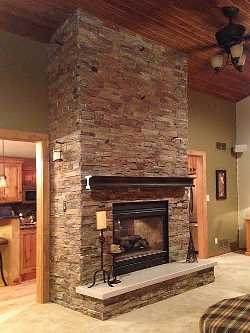 Stacked Stone Fireplace with iron railroad tie mantle  Added