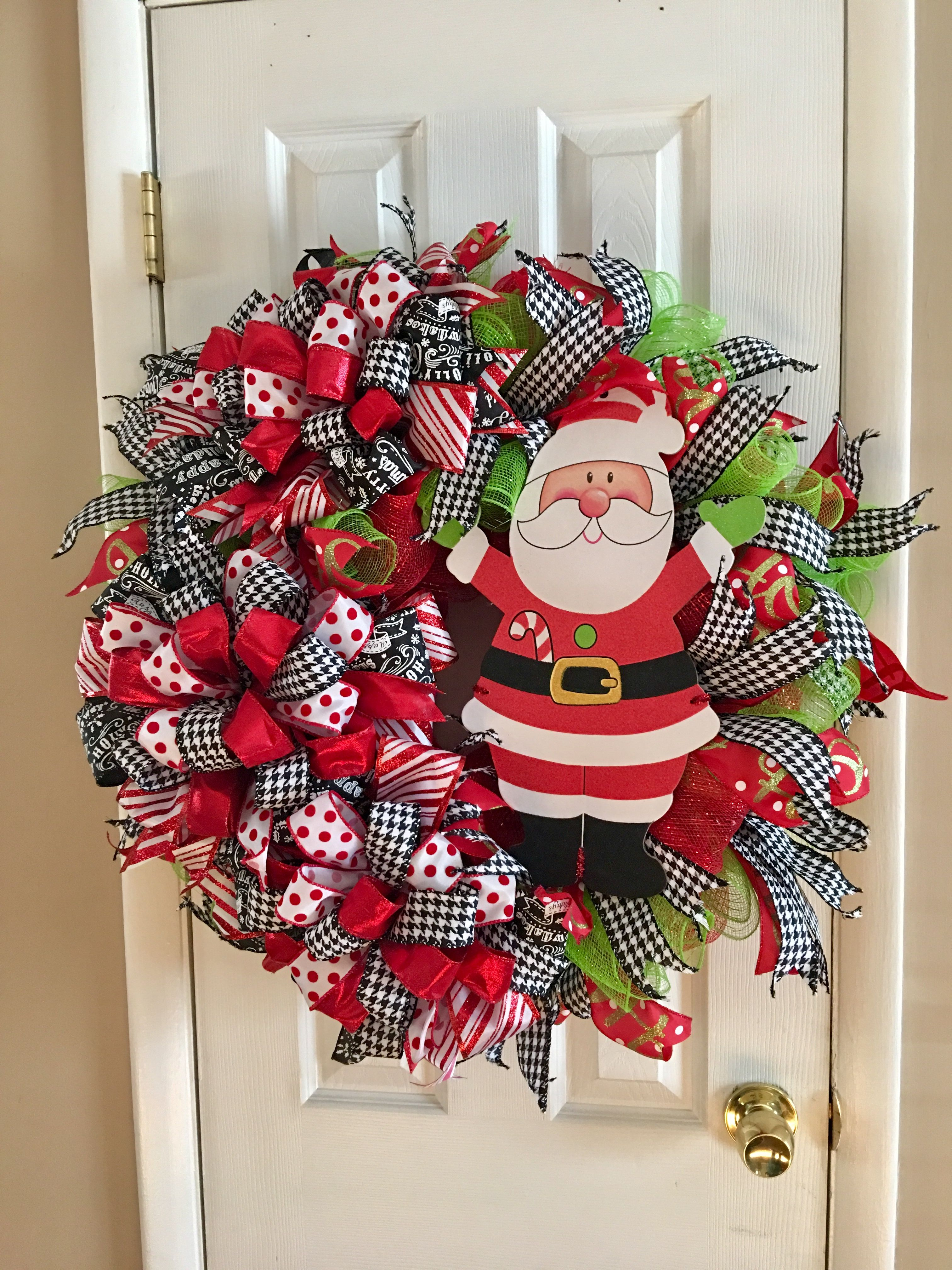 I Made This Cute Santa Christmas Wreath Made With Deco Mesh And Lots Of Ribbons Mesh Ribbon Wreaths Wreath Crafts Wreaths