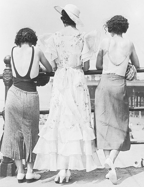 Three women photographed on Blackpool promenade during a heat wave in July 1934. The woman in the middle is wearing a mass market copy of t...