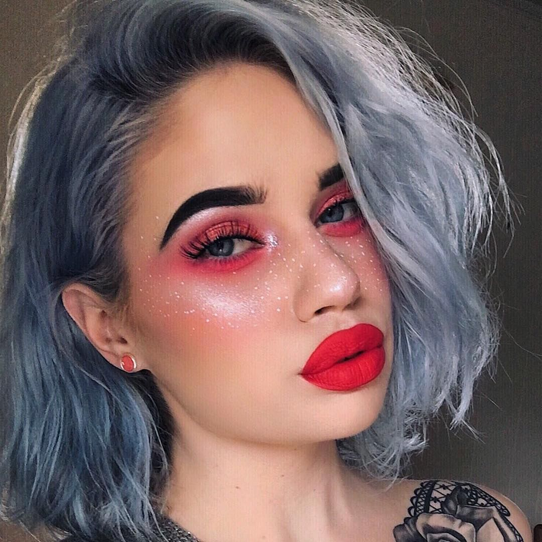 Play up bold eyes and lips with faux freckles using your