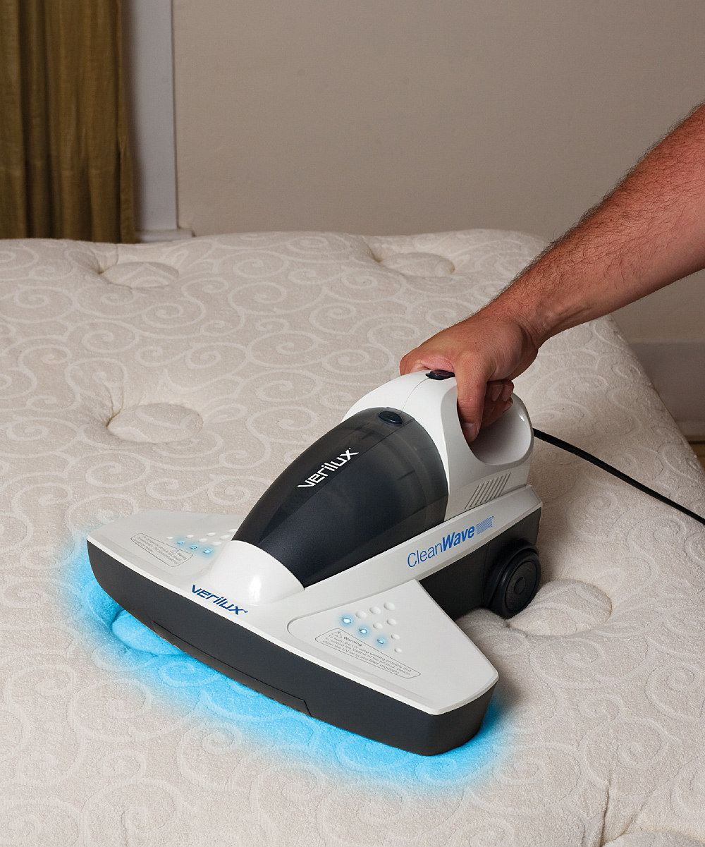 CleanWave Portable Sanitizing Vacuum I so want this