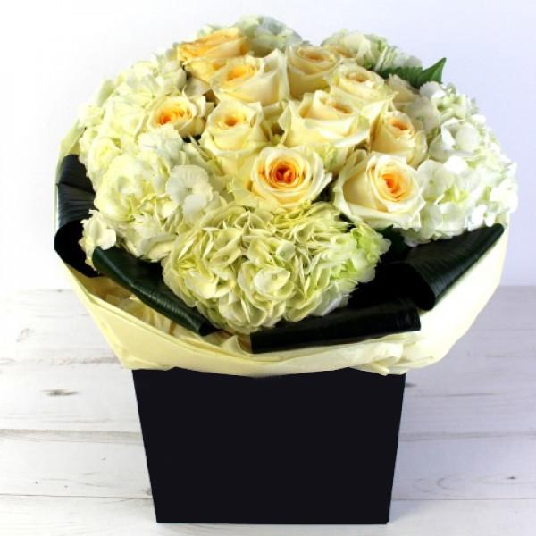 Lavish Someone With This Elegant Bouquet Of Rich Crame De La Crame Roses And White Hydrangea With A Foliage S Anniversary Flowers Valentines Flowers Flowers Uk