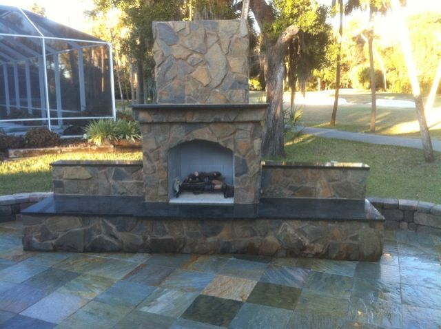Slate Patio And Outdoor Fireplace With Granite Hearth And Extended