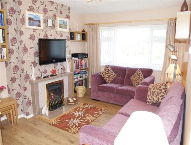 This semi-detached bungalow in Pembrokeshire enjoys a quiet location in a cul-de-sac, yet within walking distance (500 yards) of the city centre of St David's, Cathedral and the many shops, galleries, excellent eateries and pubs in Britain's smallest city.  The Cathedral is hidden in the valley beside the magnificent Bishop's Palace ruins. Close-by there are many beaches and coves including Caerfai which is just a mile away.