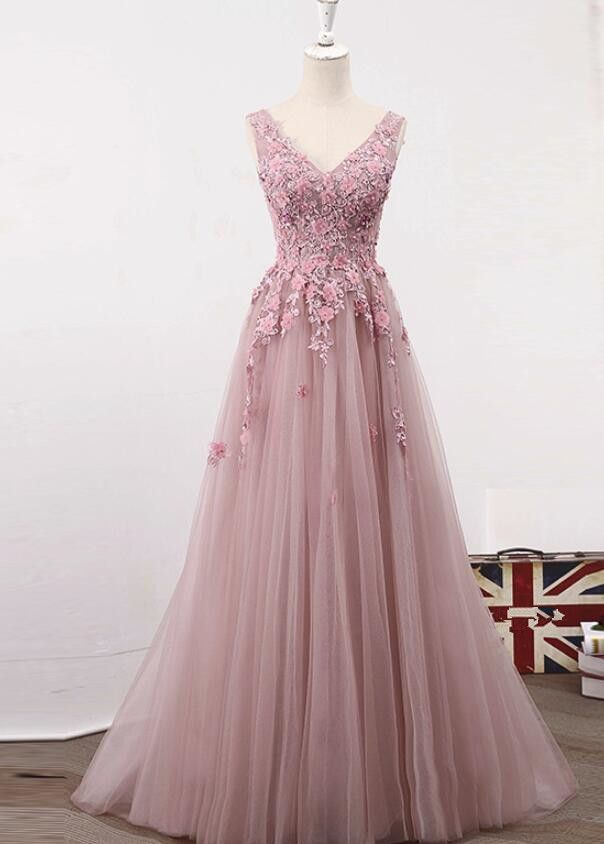 Pink Party Dress, Tulle Junior Prom Gown 2019, Long Formal Dress - Floral prom dresses, Pink evening dress, Pink prom dresses, Prom dresses lace, Prom dresses for teens, A line prom dresses -   Attention Please!  When you purchase the dress, we will email to you within 24 hours to confirm the order and size information, please check and reply in time! Thank you so much   Making time 23 weeks  Shipping time 35 working days Rush order is available, and there is no extra cost for rush order  When you place the order, please leave us the rush information, so we can do rush order for you  Custom size or color is available  Here is our email address WeddingPromDresses@outlook com, please feel free to send us email if there is any questions   Fabric Tulle  Color Pink HemlineFloor Length  NecklineVneckline Back Laceup  Custom Measurements For better fitting, You can leave us the following information in the order notes when you check out, and please have a look our measuring guide at first  1  Bust              inches  2 Waist              inches  3 Hips               inches  4  Your height without shoes           inches  5  The height of shoes         inches 7 Occasion Date          1  Packing in order to save your shipping cost, each dress will be packed tightly with water proof bag   2, Shipping by UPS or DHL or some special airline  3  Payment Paypal, bank transfer, western union, money gram and so on  4  Return Policy  We will accept returns if dresses have quality problems, wrong delivery time, we also hold the right to refuse any unreasonable returns, such as wrong size you gave us or standard size which we made right, but we offer free modify   Please see following for the list of quality issues that are fully refundable for  Wrong Size, Wrong Colour, Wrong style, Damaged dress 100% Refund or remake one or return 50% payment to you, you keep the dress  In order for your return or exchange to be accepted, please carefully follow our guide  01  Contact us within 2 day