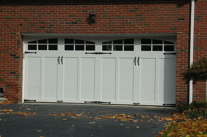 Clopay Coachman Collection Carriage Style Garage Door Design 12 With Arch3 Windows And De Carriage Style Garage Doors Garage Doors Carriage House Garage Doors