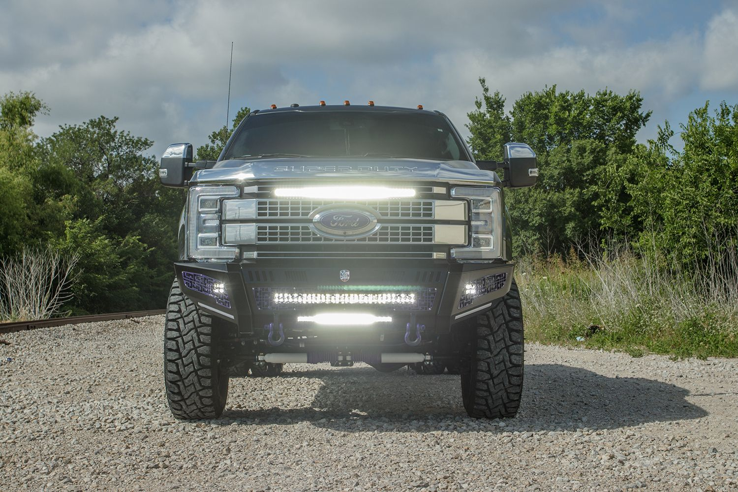 road armor identity bumpers on a lifted gray ford f350 dually with custom rigid led light bars [ 1500 x 1000 Pixel ]