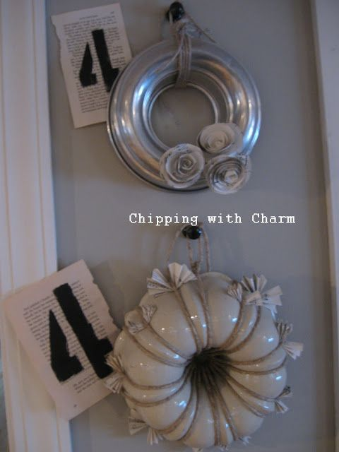 I came across these bunt pans made into wreaths or it could be wall art but to me they sure take on a form of a wreath and I absolutely love it.  It's at Chipping With Charm blogspot.