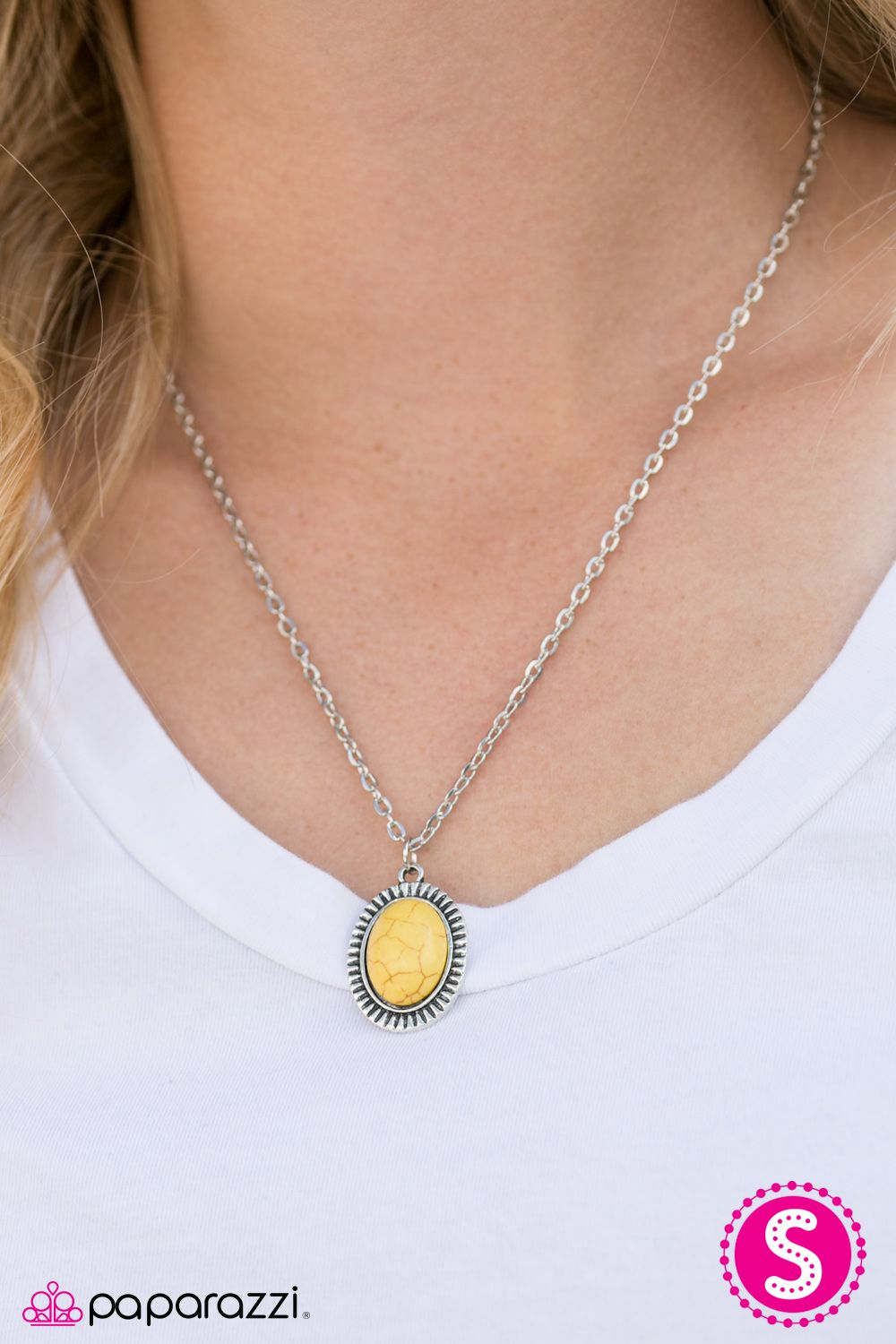 CAST IN SANDSTONE - YELLOW ($5) A sunny yellow stone is pressed into the center of a textured silver frame, creating a perfect pop of color below the collar. Features an adjustable clasp closure.
