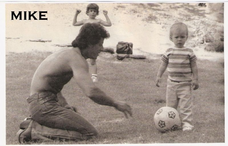 A rare picture of Sly Stallone playing with sons Seargeoh (with football), who was autistic and Sage (In the background)