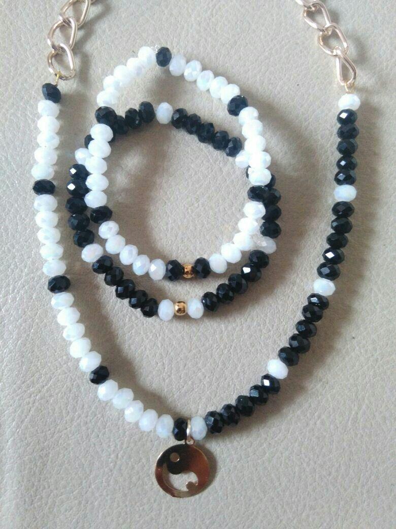 Juego de collar y pulsera con dije yin-yang en oro laminado
