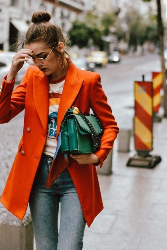 Orange pea coat with green bag and graphic rainbow tee Girlfriend is better