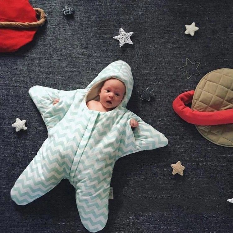 Little Star Baby Sleeping Bag With the you won't need to a lot of extra and blankets for your next trip out! This adorable starfish sleeping bag is perfect for keeping baby cozy all night long. Made of 100% cotton, it's to reduce overheating and ensure that your infant sleeps comfortably. There's plenty of room for your little one to move and kick and the sleeping bag allows infant to stretch out his/her hand by the cuffs.