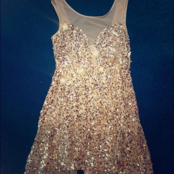 Sequin gold dress never worn. Purchased for $40 Gold sequin dress. Brand new never worn. Dresses