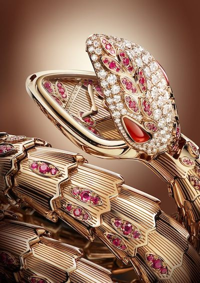 The Bulgari Serpenti two-twirl bracelet uses pave set brilliant cut diamonds and brilliant cut rubies on rose gold plaques to simulate the scales of a serpent, culminating in a stunning snake's head that opens up to reveal the watch's ruby adorned dial. (photo Lifestyle Asia)