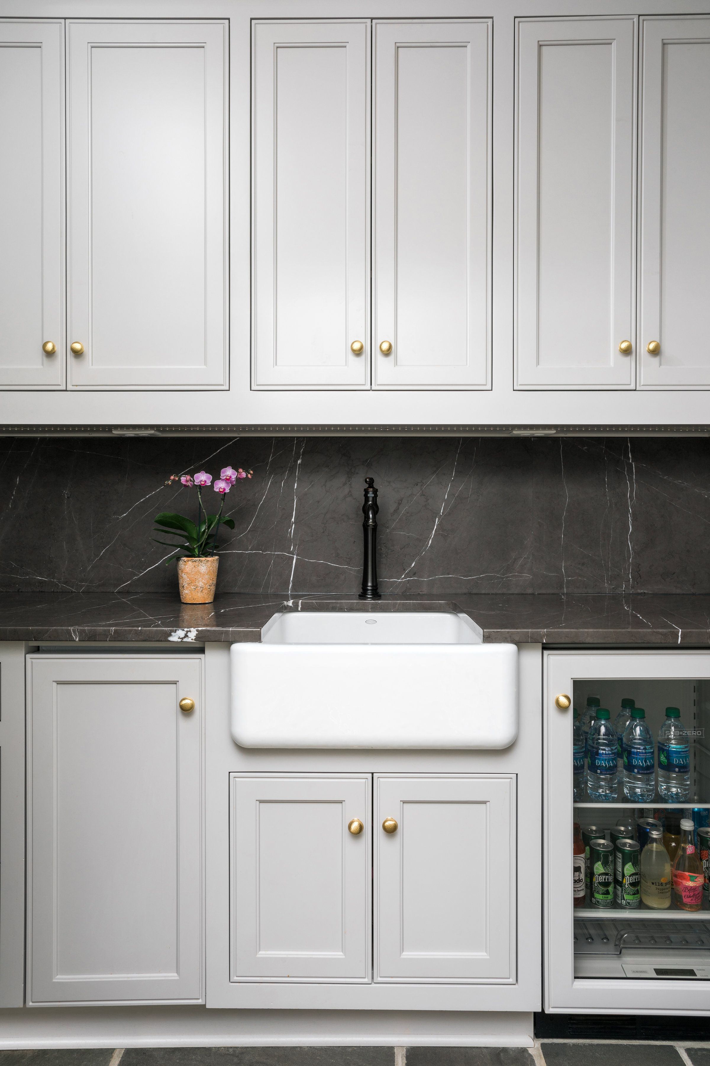 Black Marble Backsplash And Countertops On The Wet Bar With A White Apron Front Farmhouse Sink Beve Kitchen Remodel Small Kitchen Remodel Light Gray Cabinets