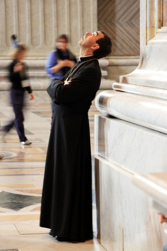Looking Up Priest At St Peters Basilica Rome Province Of