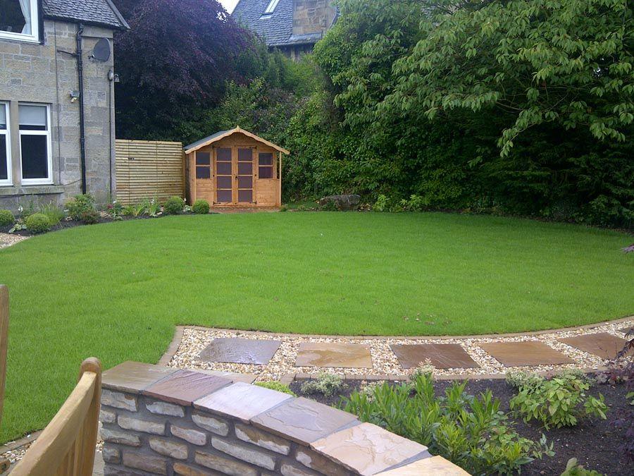 Summerhouse, lawn edging and path through gravel Lawn