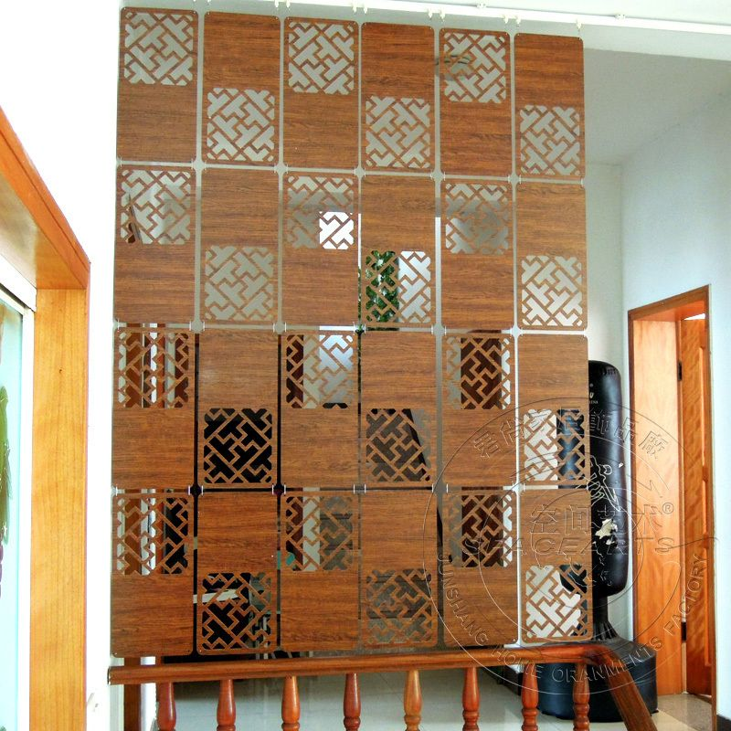 Space Art Carved wood veneer wall panels hanging off the living