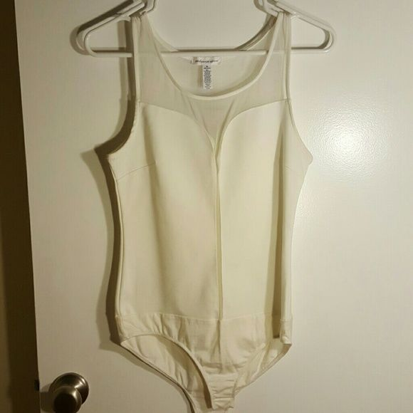Sexy bodysuit! Sexy ivory bodysuit 76% polyester  19% Rayon 5% Spandex NWOT Ambiance Apparel Tops