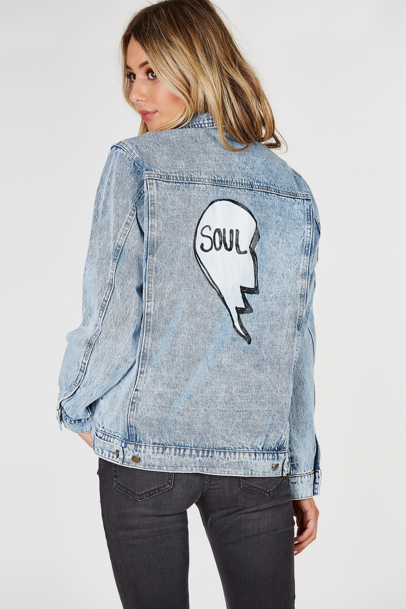 Oversized denim jacket with light acid wash. Patched in front with graphic  in the back