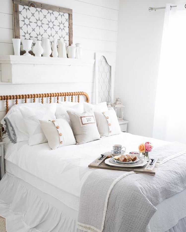 Farmhouse bedroom with antique bed and cozy pillows