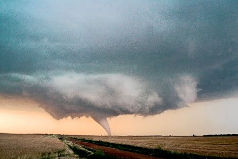 A funnel of rotating air leaps from the cloud to the ground and a twister is born over the fields of Attica, Kansas